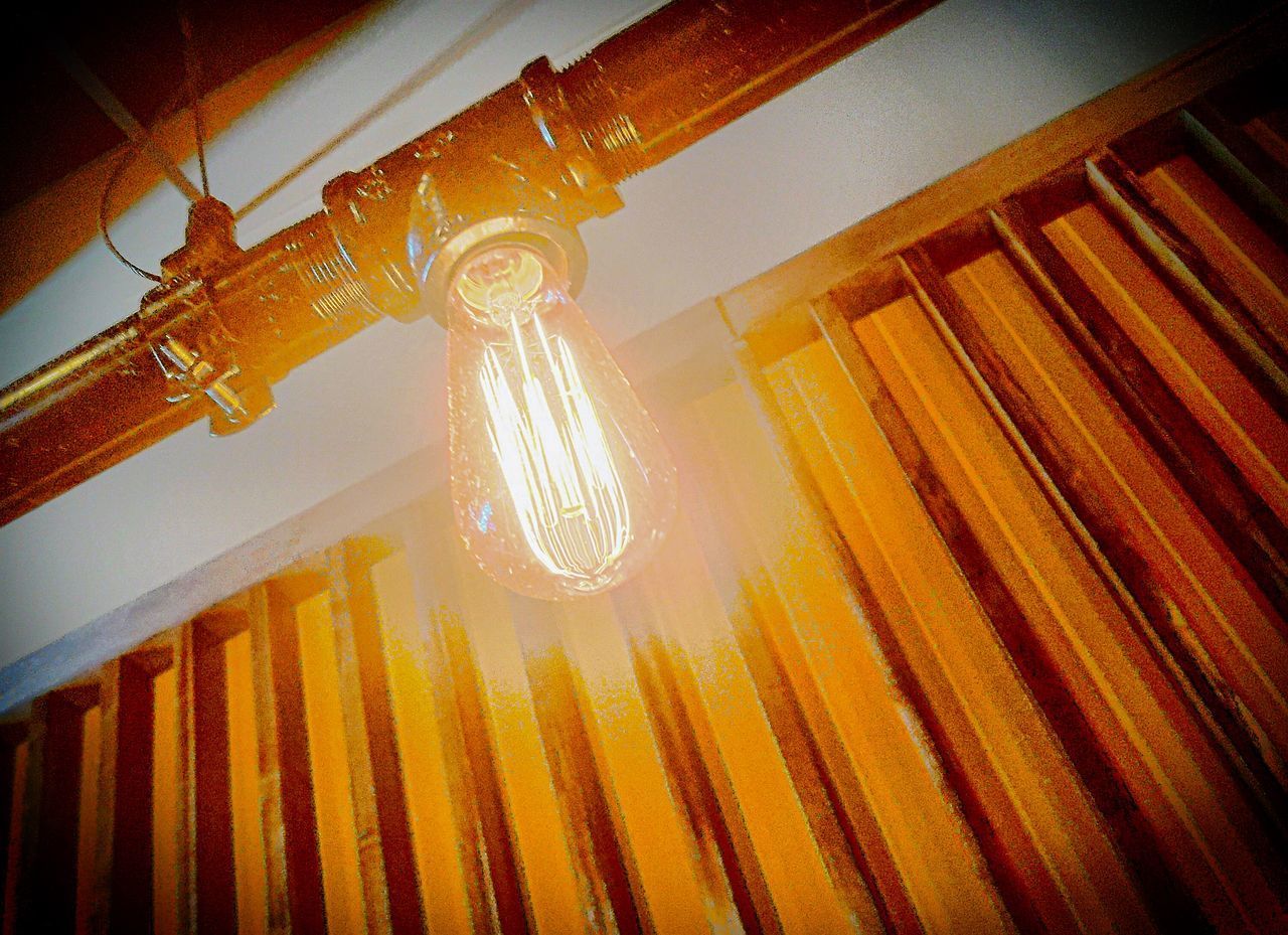 low angle view, electricity, indoors, lighting equipment, yellow, no people, light bulb, illuminated, close-up, technology, day