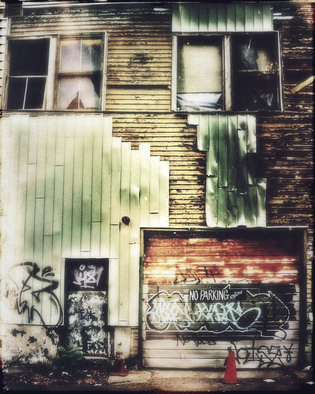 Cityscape Urban Landscape Streetphotography Graffiti Mood Urbex Decay Grimey Beauty Of Decay Melancholic Landscapes Garagedoor Door Windows Moody Faded Sign
