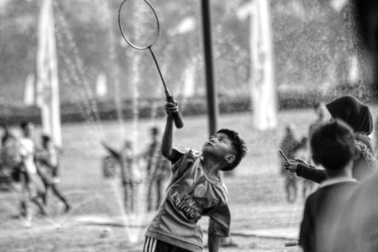 real people, leisure activity, lifestyles, sport, outdoors, day, focus on foreground, playing, boys, men, childhood, one person, young adult, people