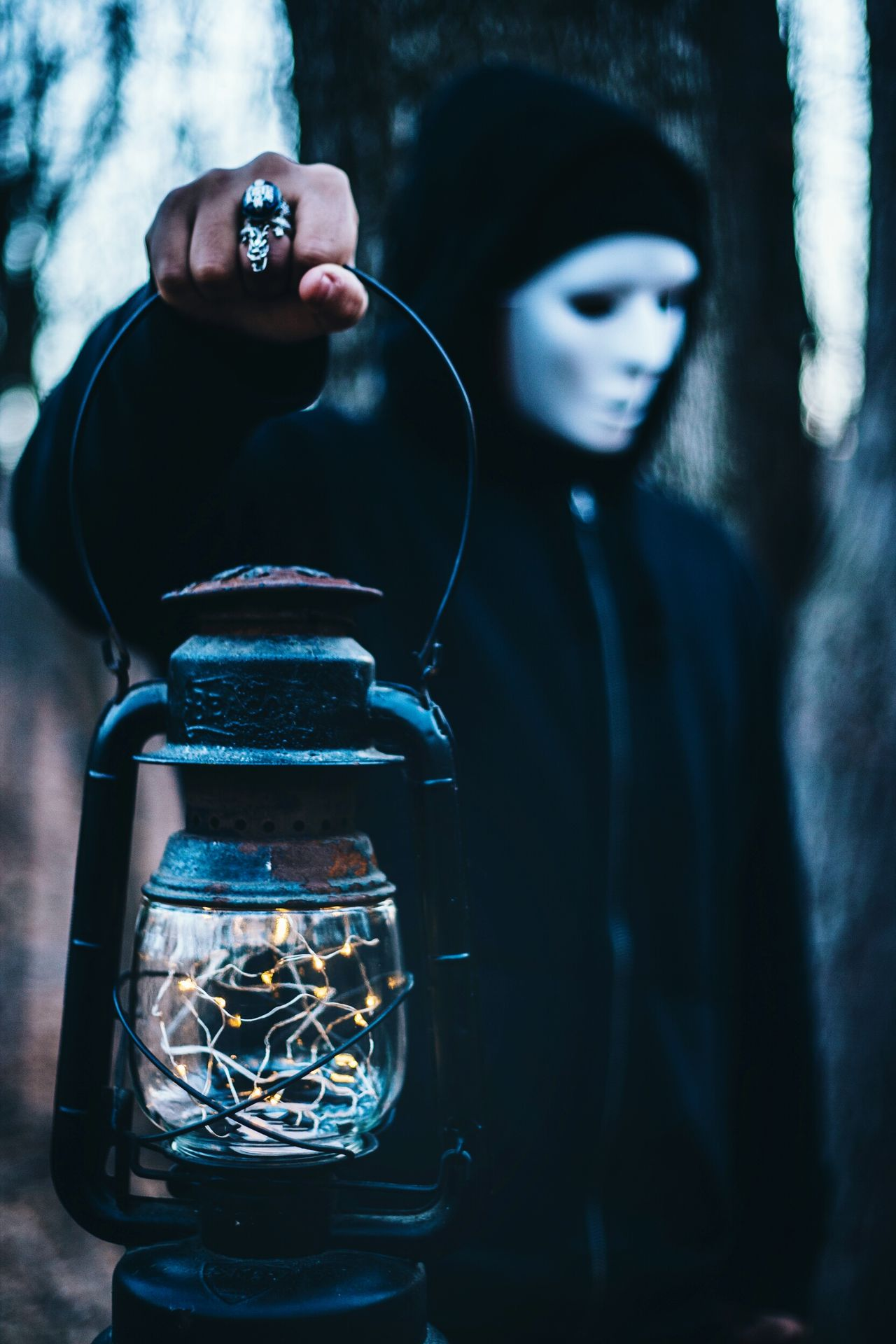 Let me be the light through the darkest of your days... This Week On Eyeem Montréal EyeEm Masterclass Moody Mask Eye For Photography Lantern Lights Illuminated Hooded Figure Woods Maskedportraits Man