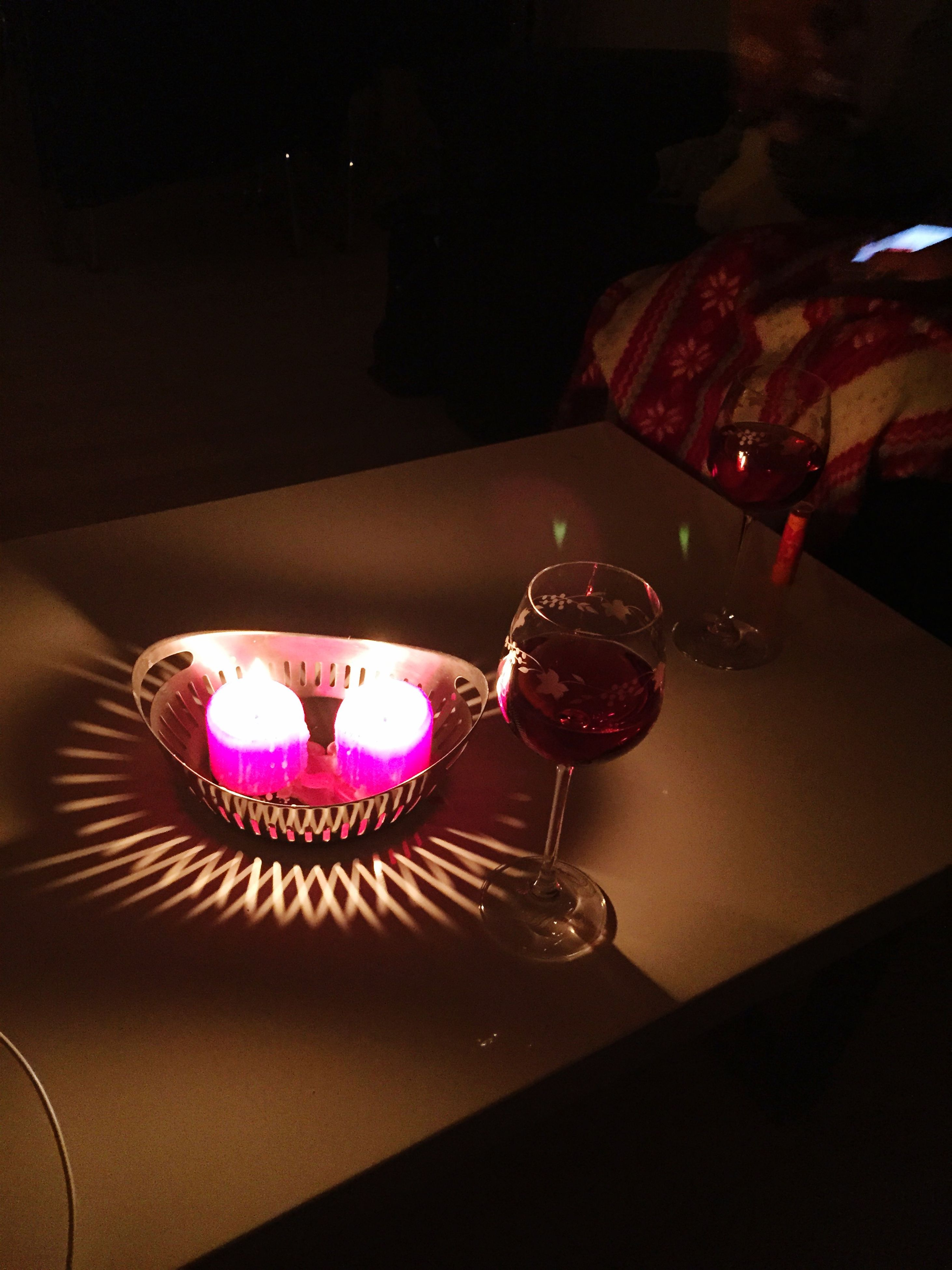 indoors, illuminated, table, night, still life, decoration, close-up, home interior, high angle view, no people, candle, glowing, lighting equipment, light - natural phenomenon, glass - material, reflection, celebration, focus on foreground, red, dark
