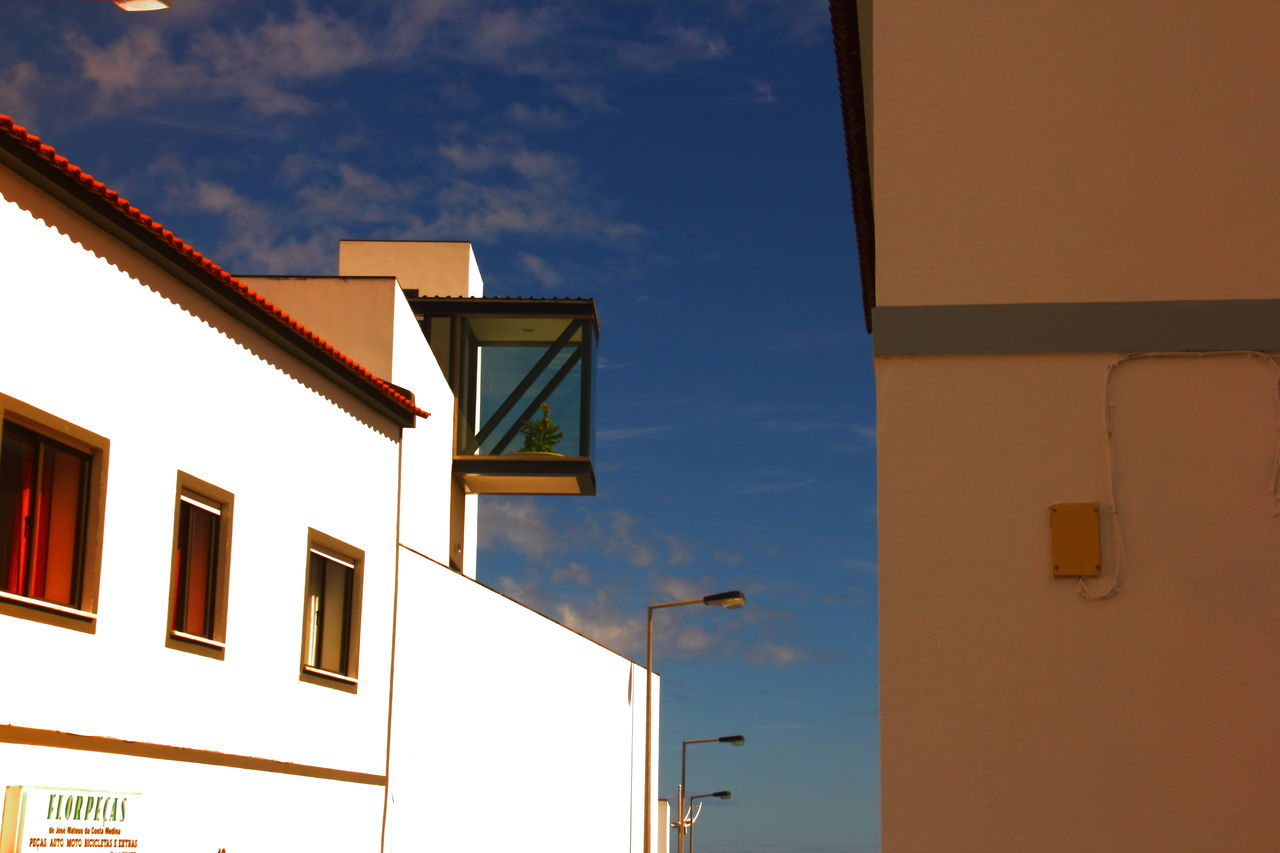 New architecture (school) versus Old Residential Buildings Architectural Feature Architecture Blue Building Exterior Built Structure City City Life Cloud Cloud - Sky Contrasting Colors Corridor View Day High Section Low Angle View Multi Colored New School Window No People Outdoors Residential Building Residential Structure Sky TakeoverContrast Window The Architect - 2017 EyeEm Awards