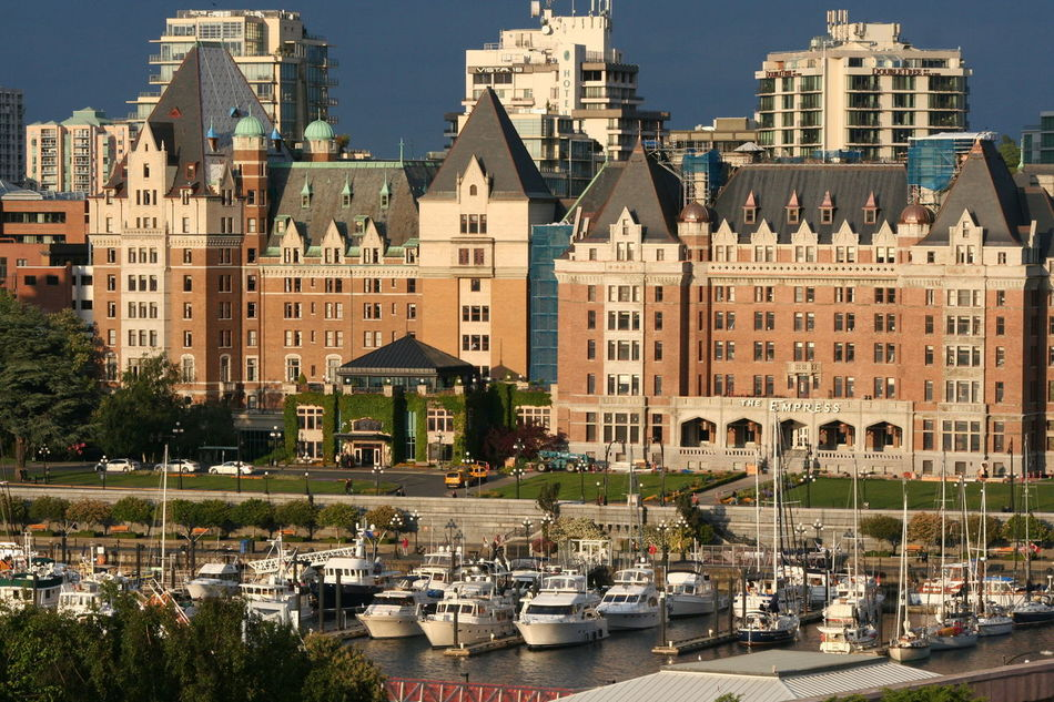 Architecture Blue Building Building Exterior Built Structure City City Life Day Grass Green Color Growth Lawn Modern No People Outdoors Side By Side Sky The Empress The Fairmont Empress Hotel Tourism Travel Destinations Tree Victoria Harbour Adapted To The City
