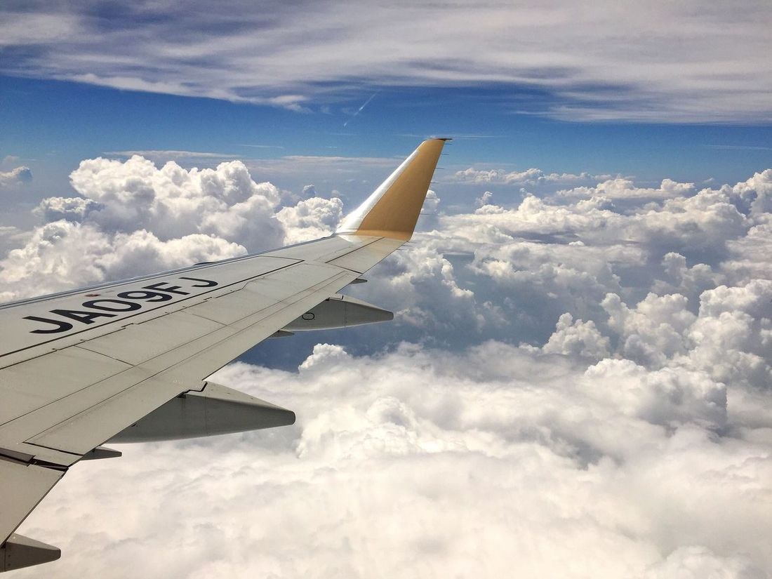 From An Airplane Window Wing Of Airplane Blue Sky And Clouds On The Clouds On The Sky