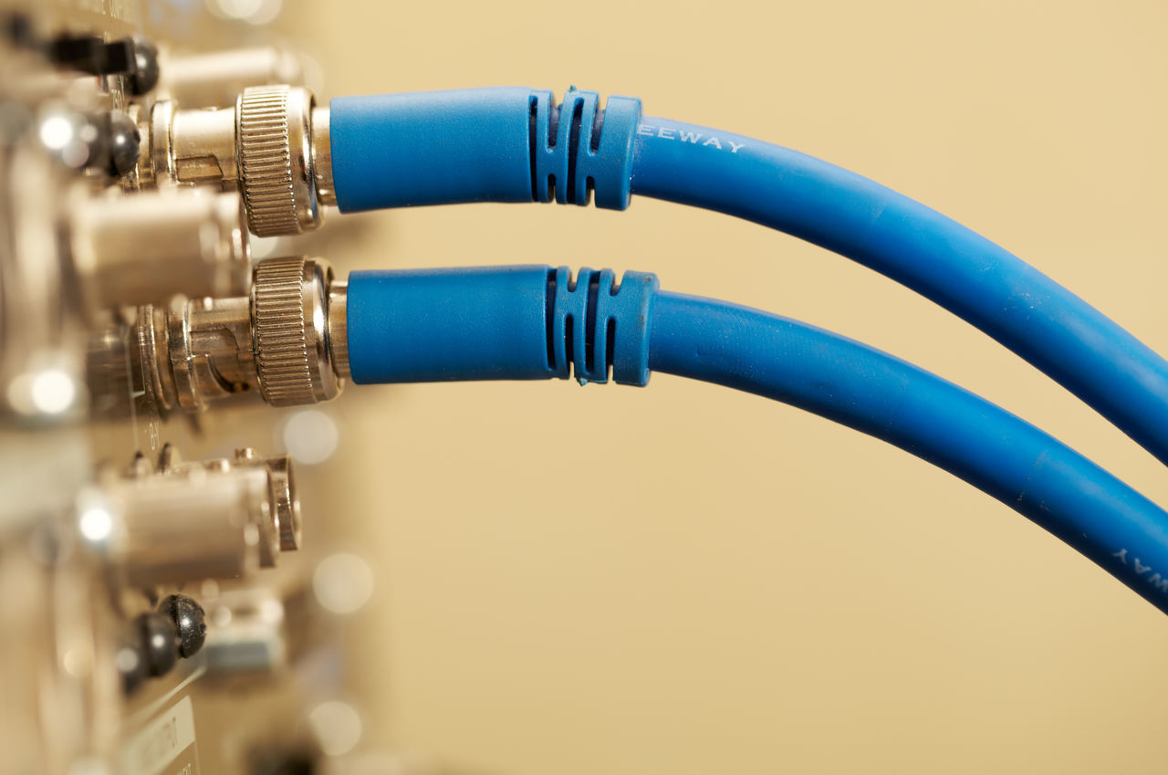 Close-Up Of Blue Cables Connected To Amplifier
