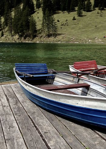 colorful boats at lake in the alps, vilsalpsee, tirol Beauty In Nature Boat Colors Enjoying Life Gondola - Traditional Boat Greenery Holiday Jetty Lake Light Mode Of Transport Moored Nature Nautical Vessel Outdoors Scenics Spring Take Your Place Tannheimer Tal Tirol  Travel Tree Vilsalpsee Water Wood - Material Second Acts