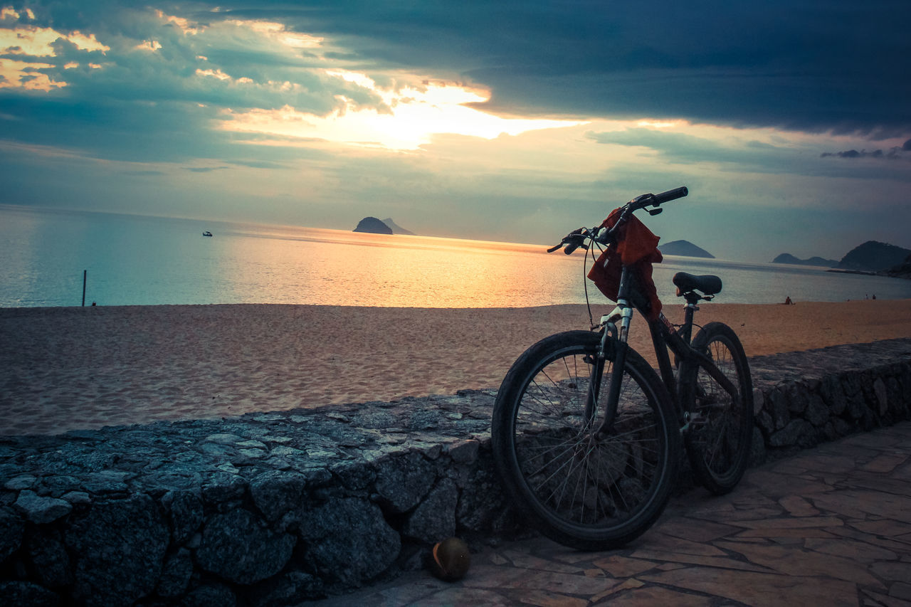 sea, sunset, sky, horizon over water, water, mode of transport, transportation, nature, bicycle, cloud - sky, outdoors, tranquil scene, scenics, beach, beauty in nature, tranquility, land vehicle, no people, day