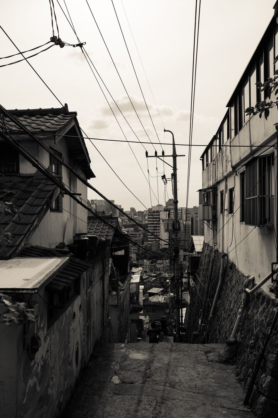 Architecture Building Exterior Built Structure Residential Building Residential Structure House Cable City Power Line  Sky Electricity Pylon Day The Way Forward Power Cable Power Supply Residential District Slum Narrow Outdoors Town Ewha Wall Picture Village South Korea