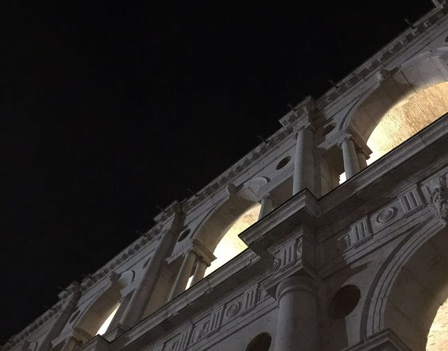 Architecture Built Structure Building Exterior Low Angle View Night Illuminated Sky History Arch Outdoors Façade Historic High Section Old Town Spire  No People City Life Basilica Palladiana Igersvicenza Architectural Feature Arched Diminishing Perspective Stone BeW Surface Level