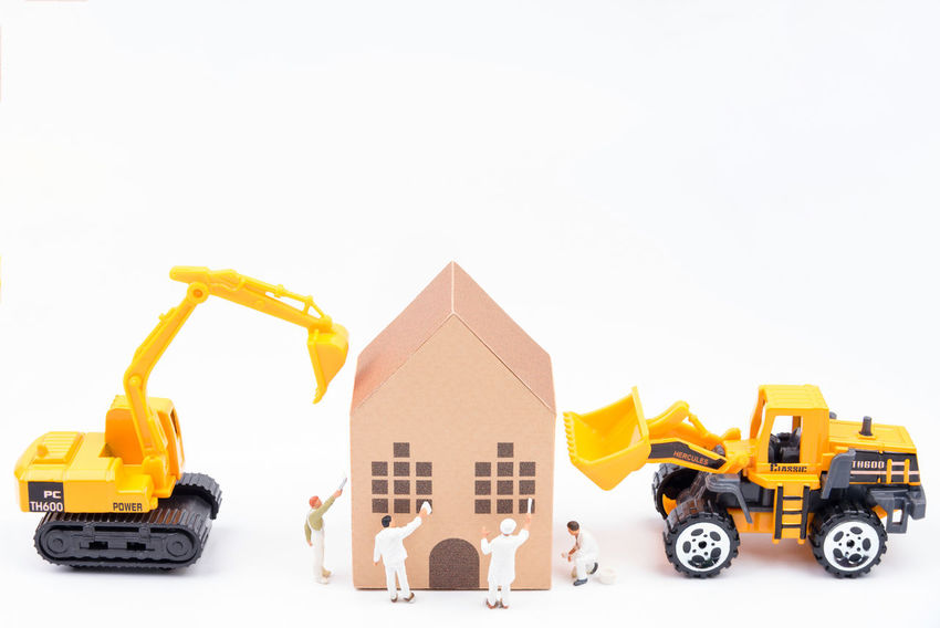 Tiny toy painter in the construction site Paper house model with toy car construction ideas concept with copyspace for your text isolated on white background. Architecture Building - Activity Business Business Finance And Industry Car Connection Construction Construction Site Construction Site Construction Vehicle Day Earth Mover Horizon Over Water House Land Vehicle Mode Of Transport No People Outdoors Toy Toy Car Transportation White Background Yellow