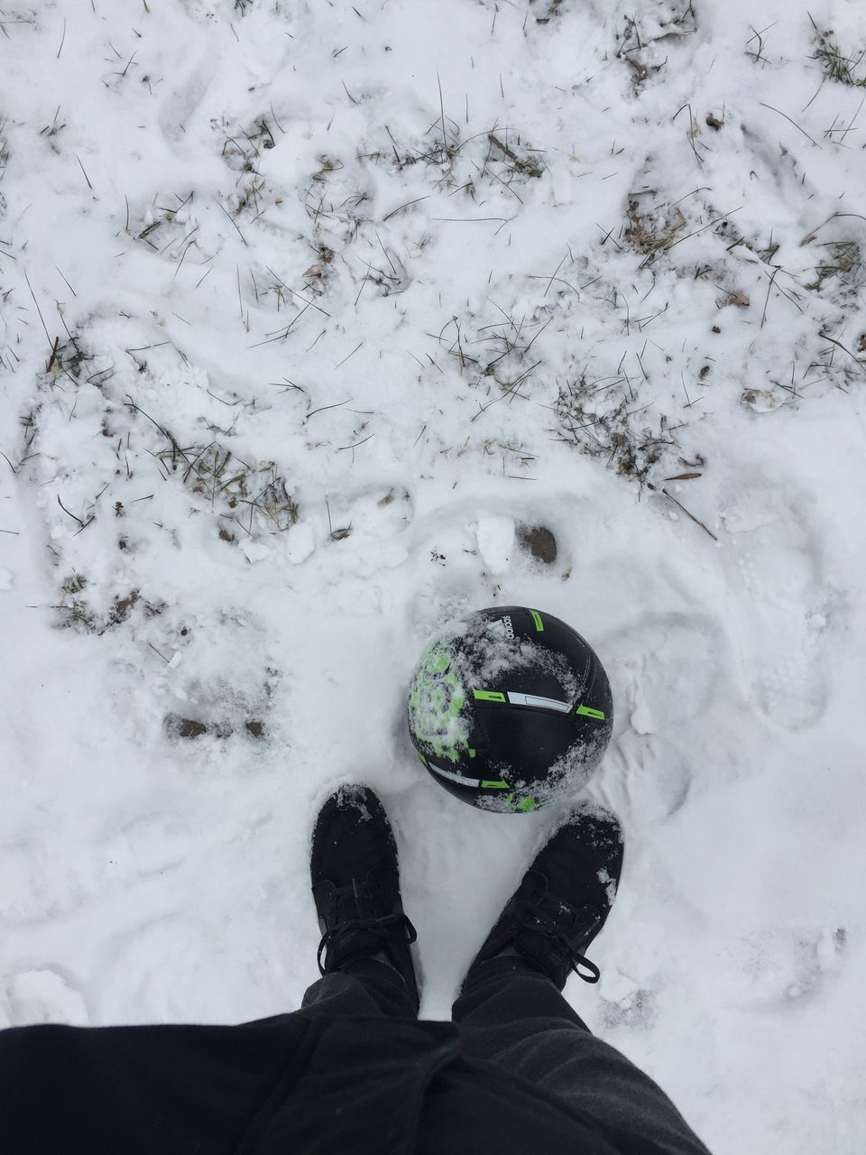 low section, winter, human leg, cold temperature, snow, shoe, personal perspective, one person, standing, weather, real people, nature, human body part, outdoors, day, men, lifestyles, water, close-up, freshness, people
