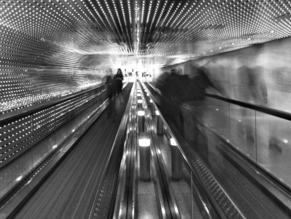 Moving Walkway  Rear View Indoors  Illuminated Convenience Lifestyles Real People Men Technology Full Length Women Architecture People Monochrome Blackandwhite Black And White Streetphotography Washington, D. C. IPhoneography Street Photography JoMo Photo Slow Shutter Washington DC Smithsonian National Gallery Of Art