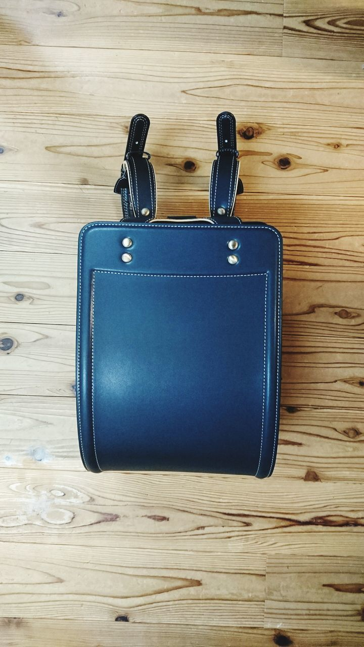 suitcase, luggage, single object, still life, table, old-fashioned, travel, indoors, wood - material, no people, blue, directly above, close-up, day