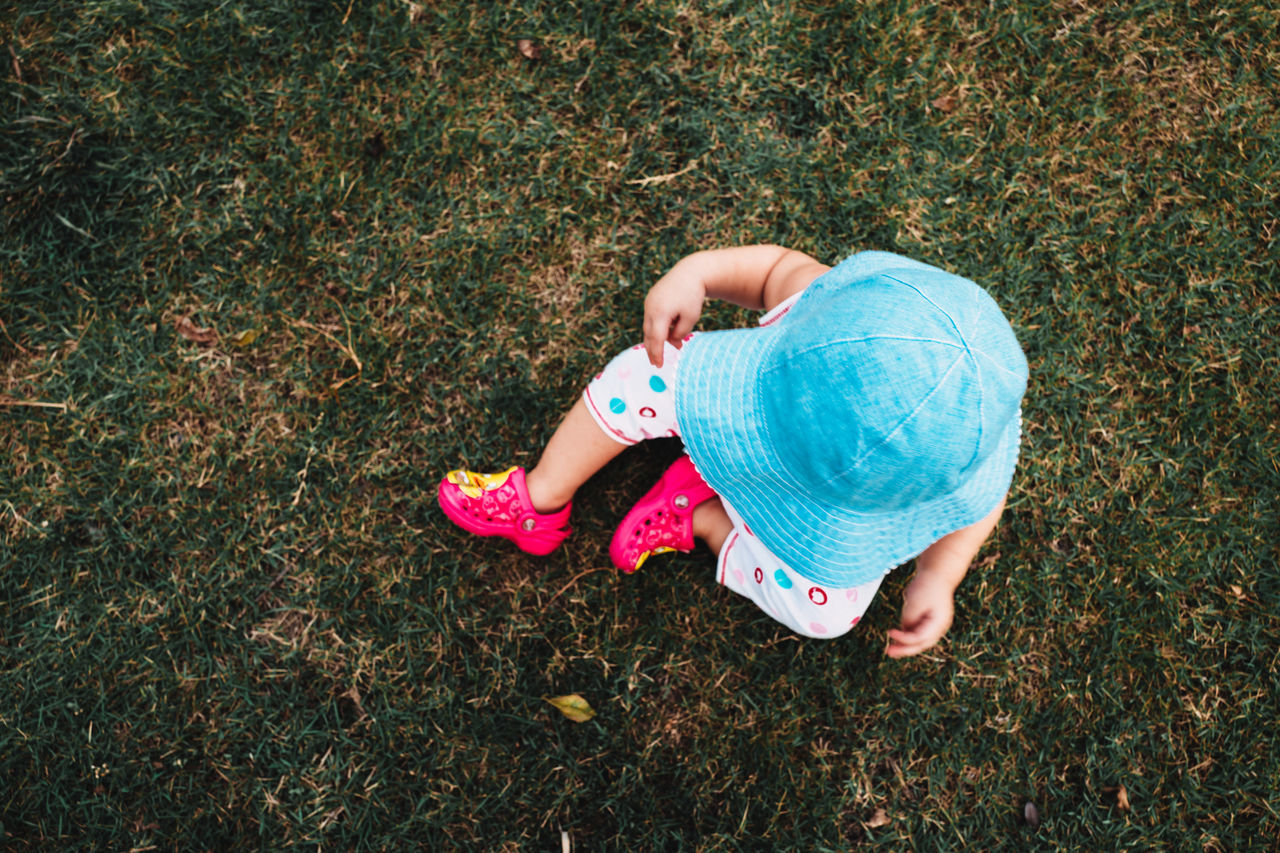 blue hat child touch and learn about grasses Babies Only Baby Babyhood Casual Clothing Child Childhood Children Cute Day Directly Above Full Length Grass Grass High Angle View Lying Down Nature One Person Outdoors Pacifier People Plaing Real People Relaxing Siting