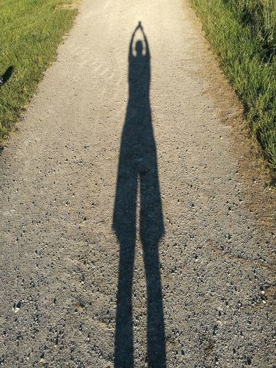 Shadow Focus On Shadow Sunlight High Angle View Real People Day Outdoors One Person Standing Silhouette Planet Earth