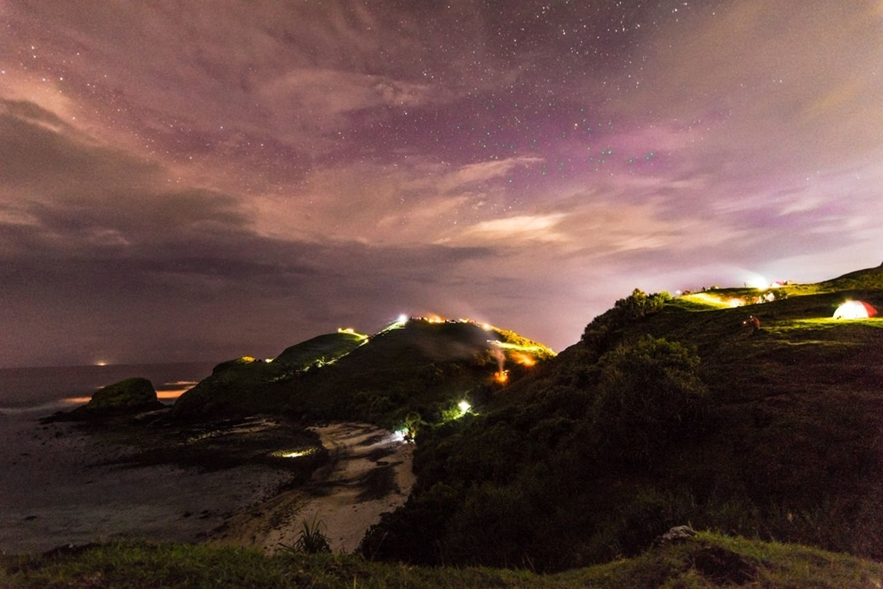 cloud - sky, sky, nature, scenics, no people, dramatic sky, beauty in nature, tranquility, tranquil scene, outdoors, mountain, night, illuminated, landscape, sea, horizon over water, grass, water, astronomy, galaxy
