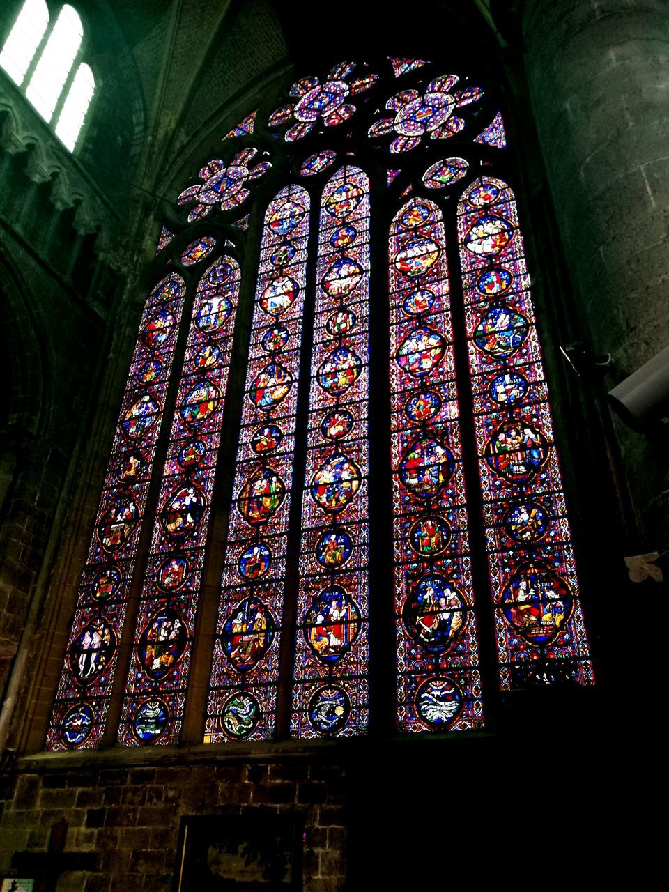 stained glass, indoors, architecture, place of worship, window, built structure, religion, spirituality, no people, multi colored, day, low angle view, close-up