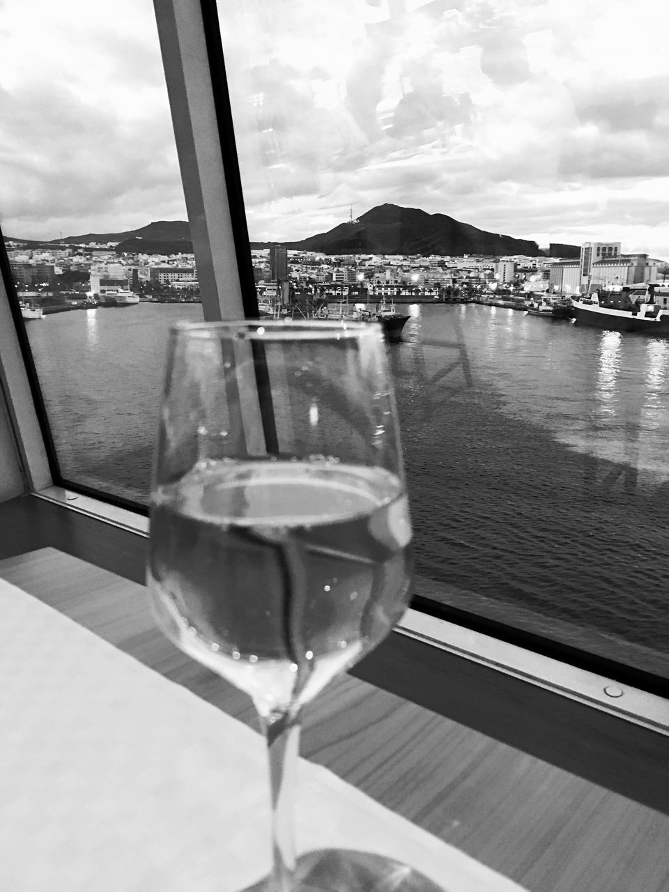 drink, table, sky, food and drink, cloud - sky, drinking glass, wineglass, water, refreshment, alcohol, wine, alcoholic drink, no people, sea, day, built structure, mountain, nature, close-up, outdoors, scenics, architecture, nautical vessel, beauty in nature, freshness