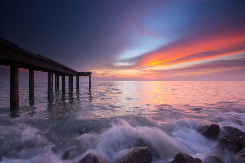 Sunset at the beach Fishing Holiday Jetty Long Exposure Malaysia Ocean Rock Scenics Sea Seascape Splash Sunset Water Wave Wood
