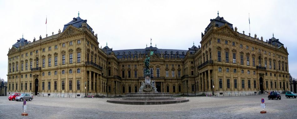Wuerzburger Residenz Panoramic capture of the Wuerzburger Residenz with fountain in foreground. Building Europe Famous German Germany Historic Historical Building Landmark Luxury Magnificent Mansion Opulent Palace People Period Power Renaissance Residence Residenz Rich Tourist Travel Wealth Wurzburg Residence Würzburg