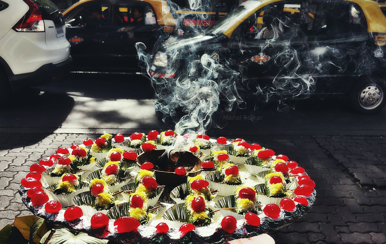 freshness, food and drink, smoke - physical structure, red, food, no people, flower, day, outdoors, unhealthy eating, plate, sweet food, close-up, ready-to-eat