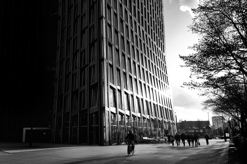 Architecture City Building Exterior People Built Structure Sky Day Hard Light Street Streetphotography Black And White Photography Hamburg Contre Jour Steel Structure  Smartphonephotography Travel Destinations Reeperbahn  St. Pauli Bikers City Life City Streets  Walking Around The City