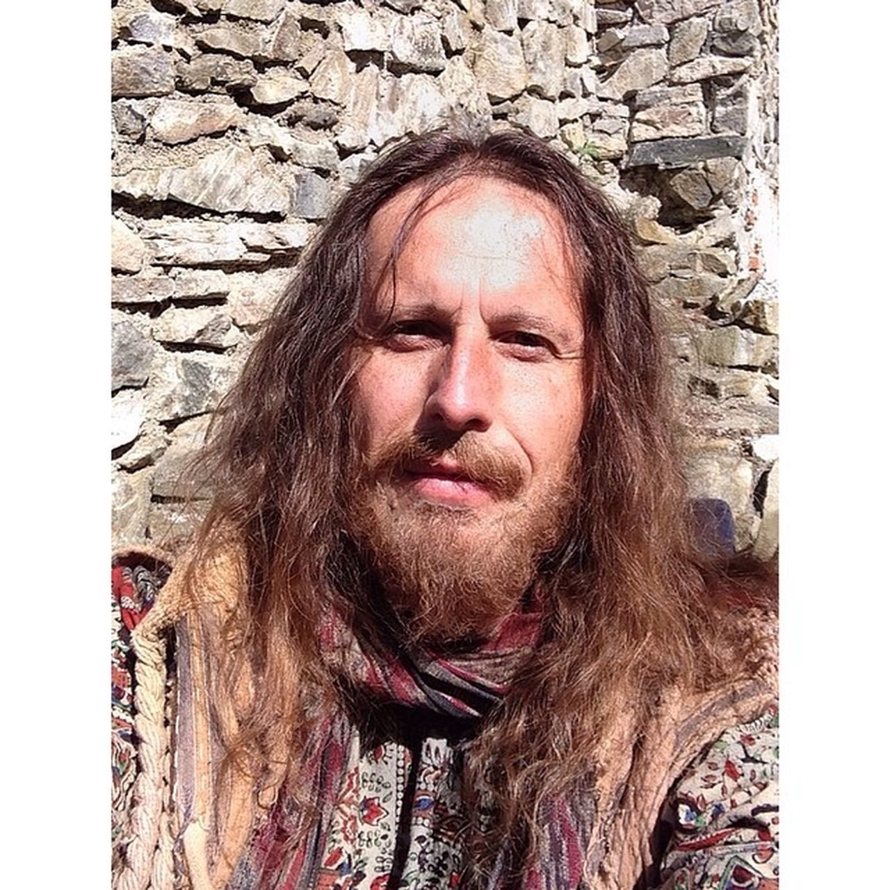 portrait, beard, real people, mature adult, looking at camera, one person, front view, one man only, long hair, mustache, only men, mature men, headshot, outdoors, human face, architecture, day, men, adult, built structure, human body part, adults only, people, close-up, young adult