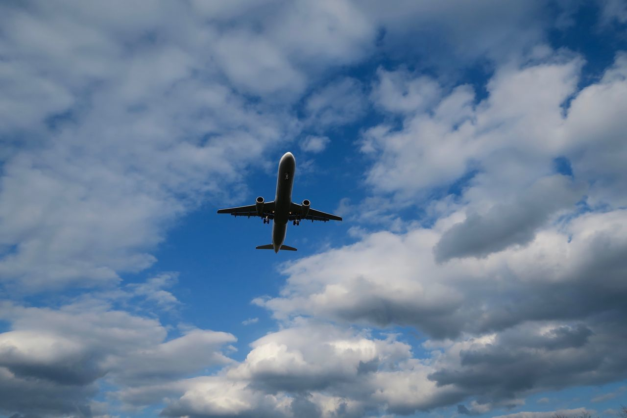 Low Angle View Of Airplane Flying Against Sky