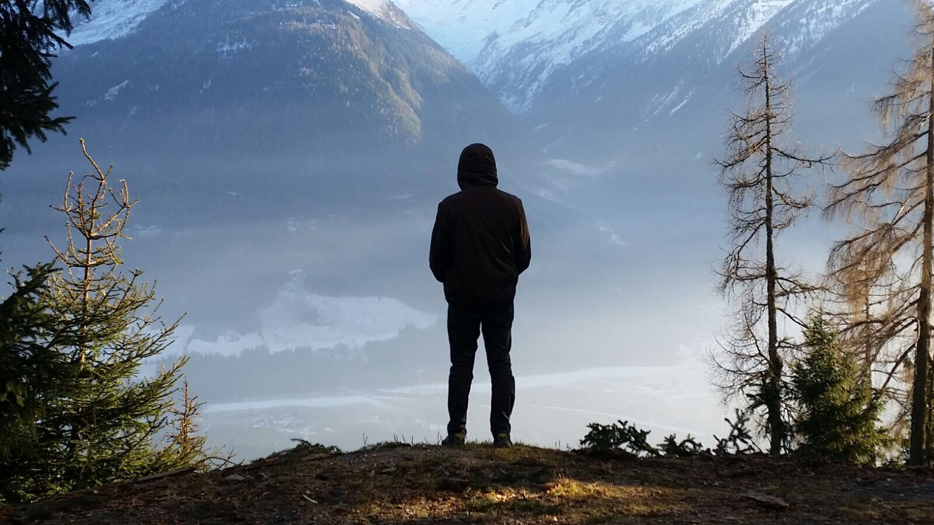 mountain, standing, scenics, tranquil scene, rear view, full length, tree, remote, men, leisure activity, tranquility, beauty in nature, lifestyles, getting away from it all, idyllic, mountain range, solitude, nature, non-urban scene, relaxation, vacations, tourism, escapism, carefree, majestic, mountain peak, outdoors, day