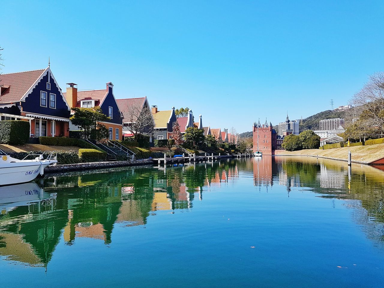 Reflection Water Sky Outdoors Travel Destinations Tranquility Architecture Tree Reflection Lake Nature No People Day Standing Water Building Exterior Lake Vacations Urban Skyline Beauty In Nature Huis Ten Bosch Fukuoka,Japan Japan Nagasaki Amsterdam Village Colorful