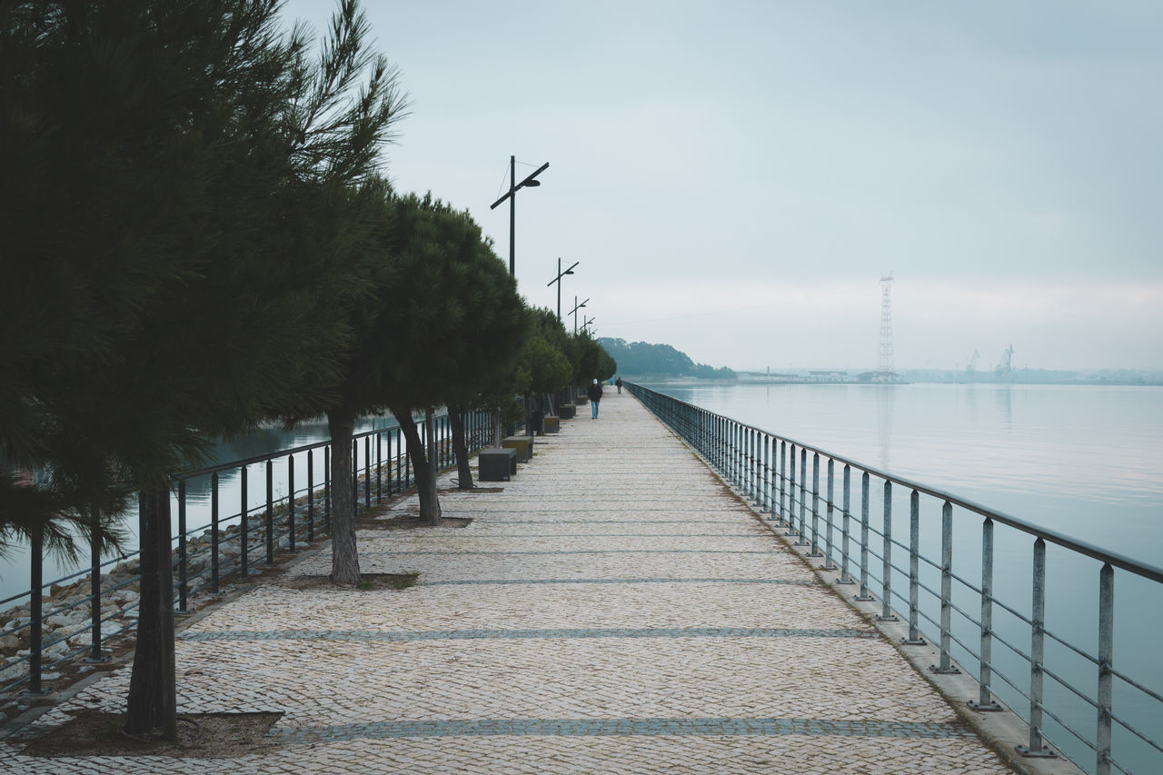 Beach Beauty In Nature Blue Day Haze Lake Lakefront Nature No People Outdoors Portugal River Sky Street Tranquility Tree Walk Water Wheelchair Access