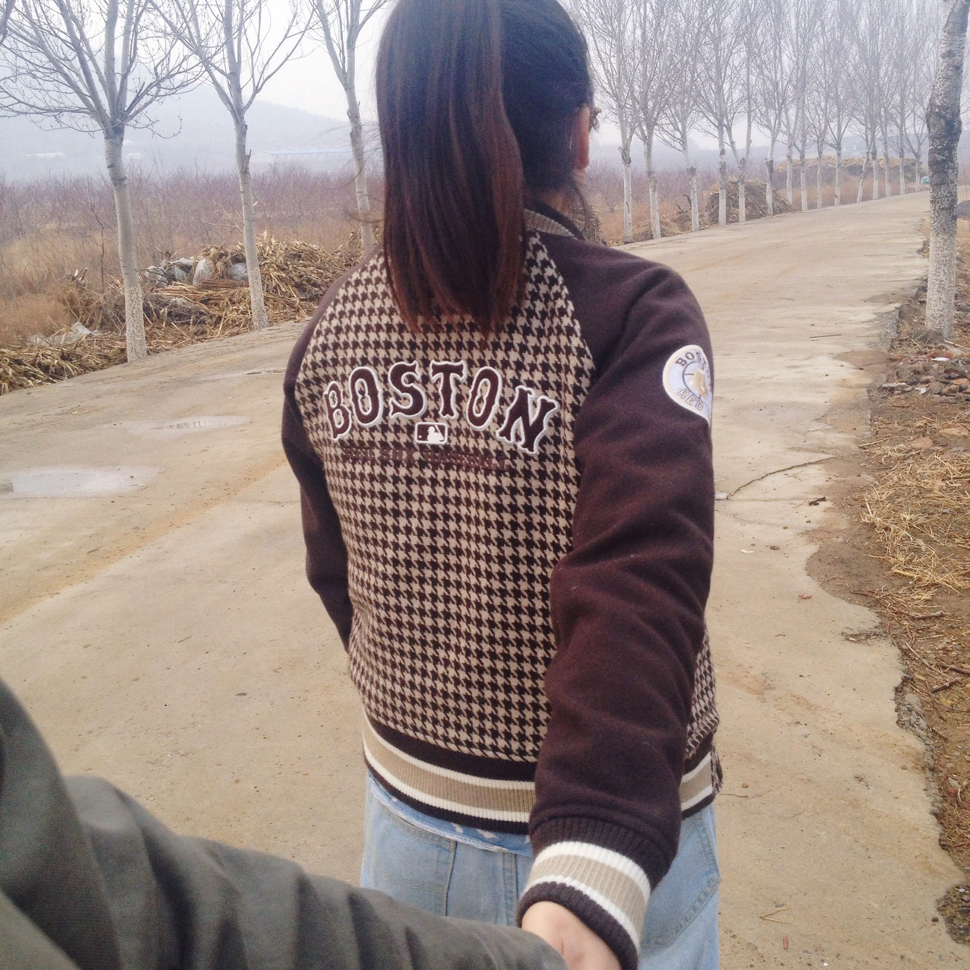 lifestyles, leisure activity, casual clothing, rear view, standing, three quarter length, person, tree, warm clothing, day, focus on foreground, long hair, outdoors, sunlight, young adult, field, waist up
