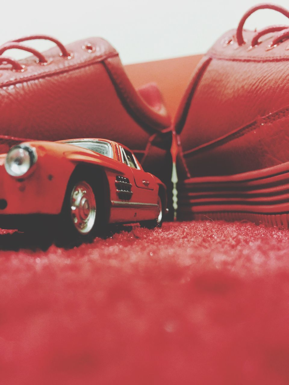 red, selective focus, still life, toy car, no people, close-up, indoors, day