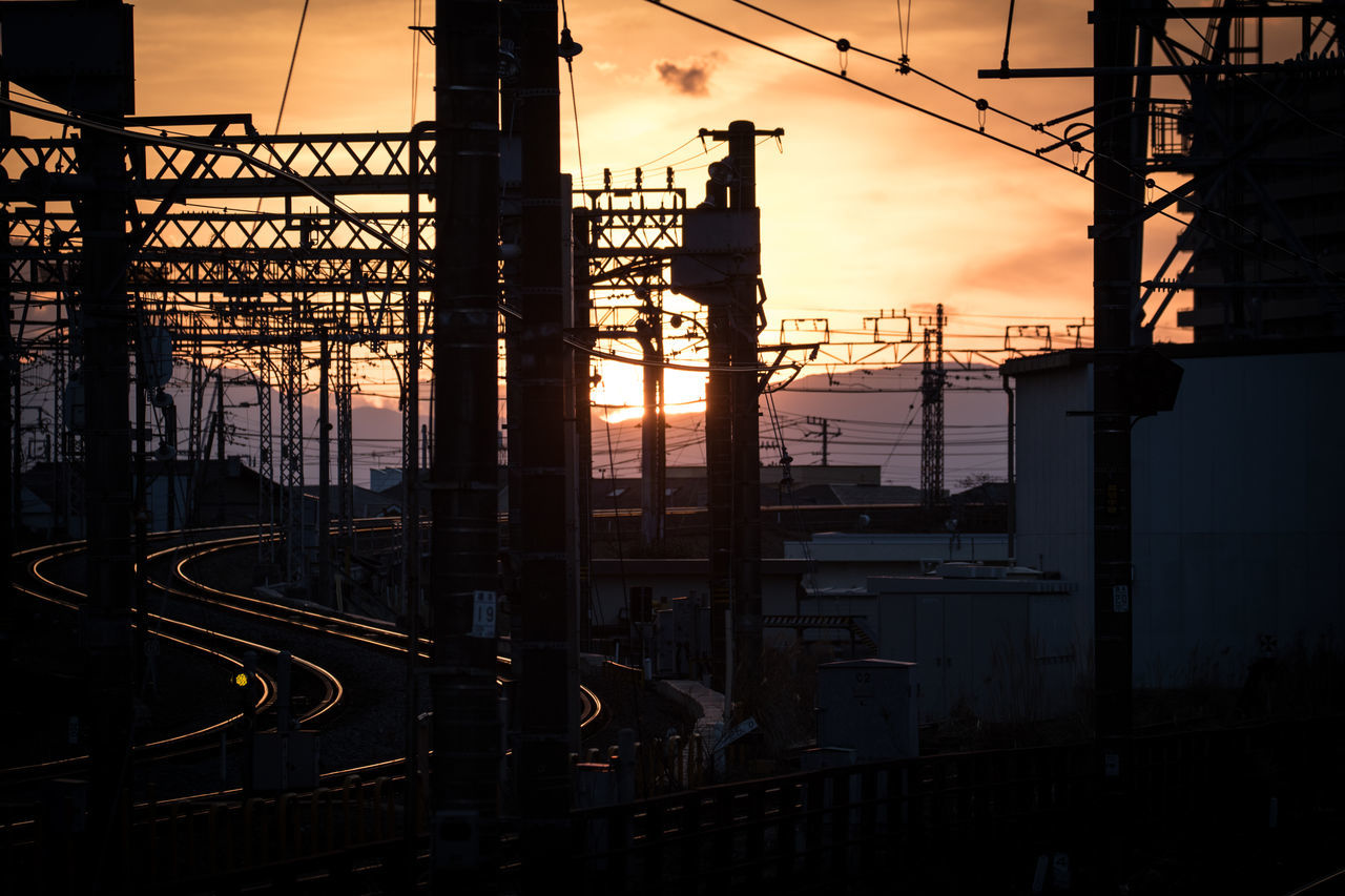 sunset, architecture, built structure, connection, silhouette, cable, sky, electricity pylon, no people, transportation, outdoors, building exterior, complexity, city, nature, day