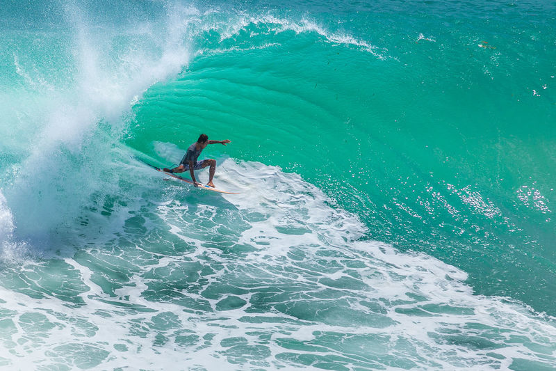Local surfer riding big green wave at Padang Padang beach, Bali, Indonesia Bali Surfer Tube Adventure Barrel Beauty In Nature Extreme Sports Green Room High Angle View Leisure Activity Motion Outdoors Scenics Sea Skill  Sport Surfing Vacations Water Waterfront Wave