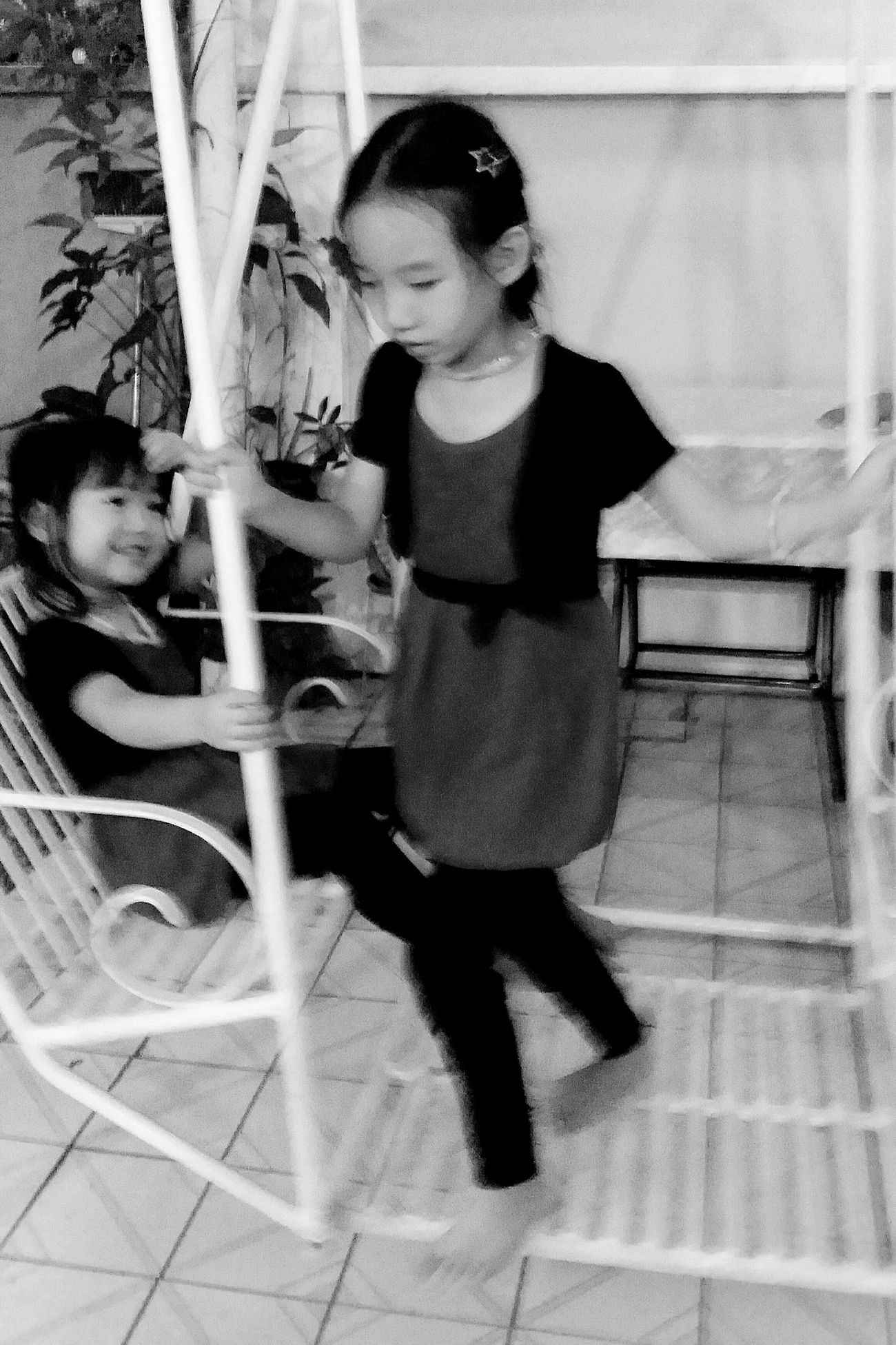 Megan Charley Streetphotography Cousins  Swing Streetphotography Singapore