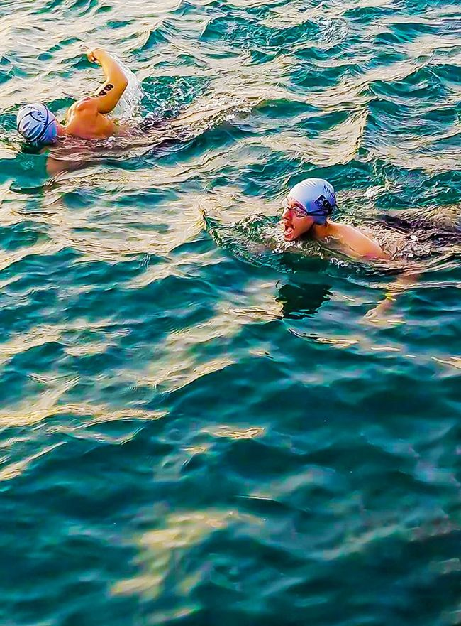 Two Is Better Than One Water Swimming Swimmers Water Reflections Waves Wavey Water Deep Water Water Sports Water Activities Racing Men People Watching Rippled Waterfront High Angle View Sport Water Surface Outdoor Activities Pair Outdoor Sports Reflection Floating On Water Sea Nature