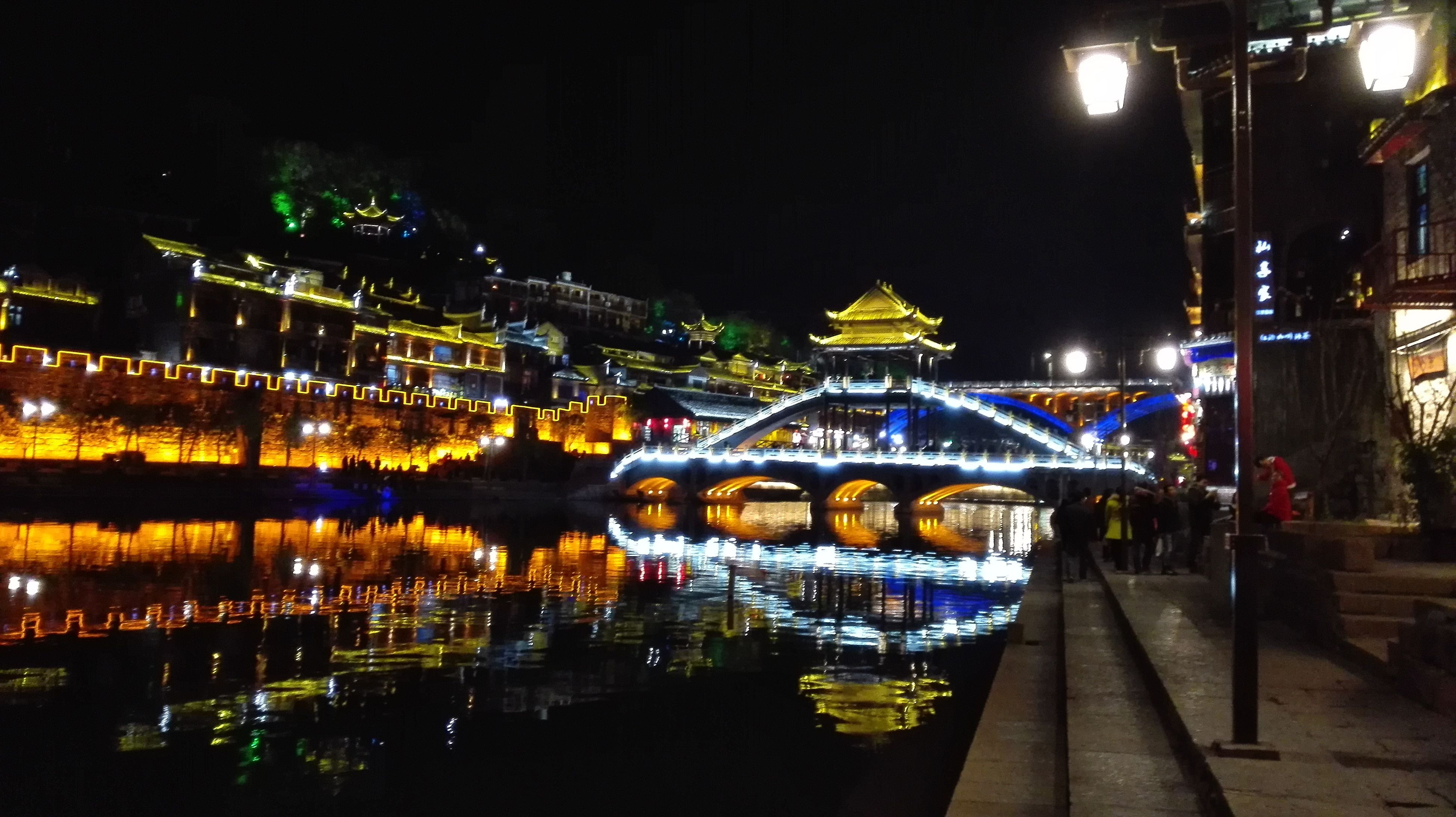 illuminated, night, architecture, built structure, building exterior, city, transportation, water, bridge - man made structure, lighting equipment, reflection, sky, street light, city life, river, connection, outdoors, mode of transport, high angle view, light - natural phenomenon
