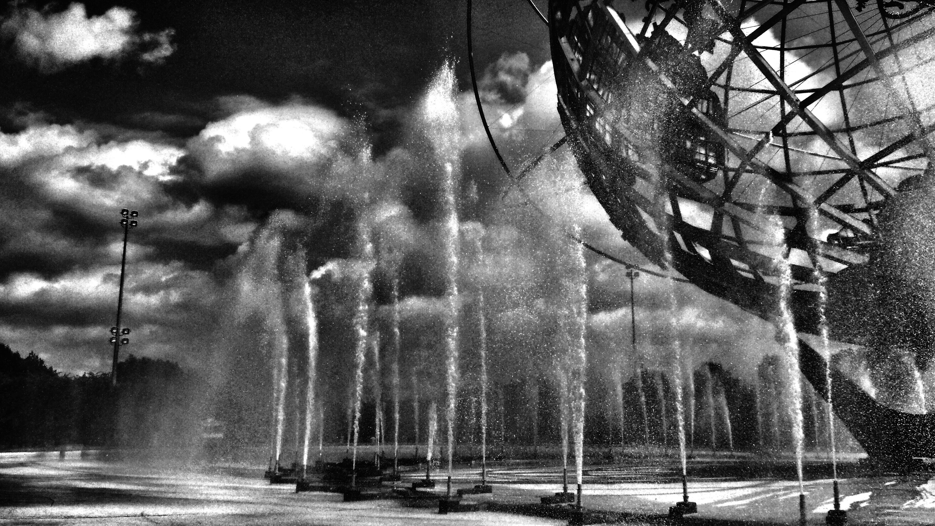water, nautical vessel, waterfront, transportation, sky, mode of transport, tree, reflection, boat, motion, nature, fountain, river, outdoors, day, incidental people, splashing, cloud - sky, built structure, lake