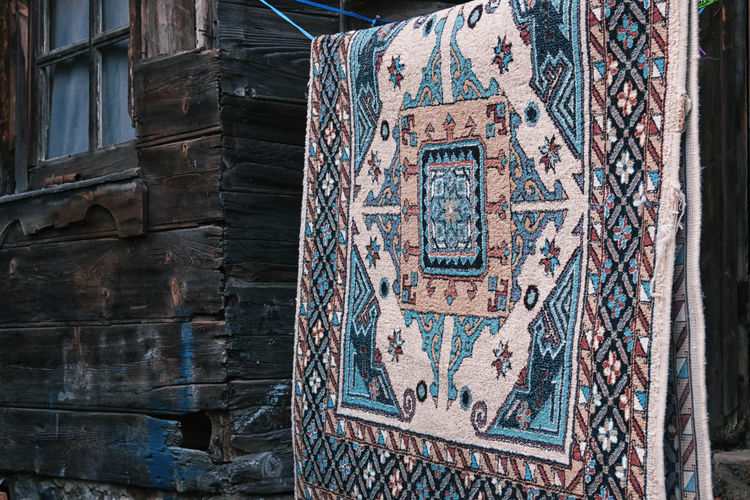 Blue Carpet Abstract, African, Ancient, Art, Background, Brown, Carpet, Collection, Color, Culture, Decorative, Design, Element, Ethnic, Fabric, Geometric, Graphic, Illustration, Lines, Material, Mishmash, Mix, Motifs, Natural, Old, Ornament, Patch, Patchwork, Popula Architecture Art Blue Building Built Structure Close-up Day Design Full Frame Hanging, Literally Multi Colored No People Outdoors Persian Carpet & Rug