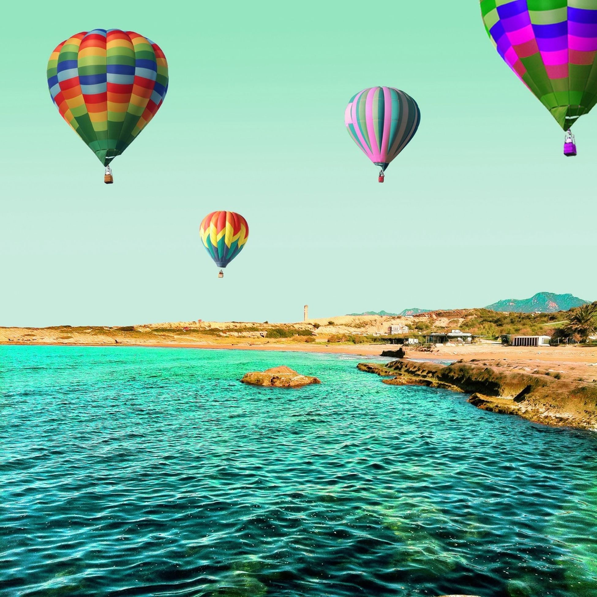 hot air balloon, mid-air, balloon, outdoors, multi colored, lantern, enjoyment, leisure activity, large group of people, fun, vacations, blue, beach, togetherness, flying, recreational pursuit, adventure, traveling, summer, holiday