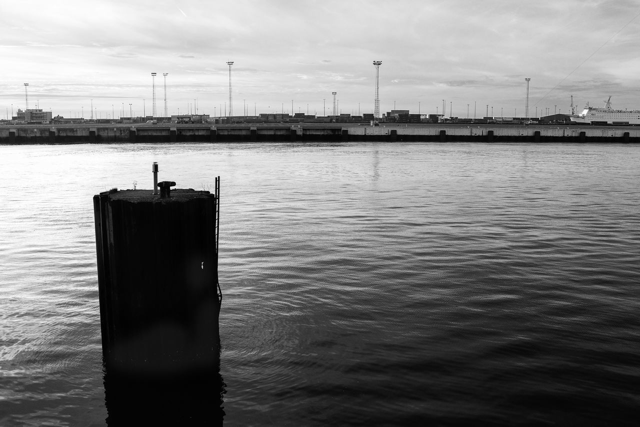 water, sky, waterfront, day, connection, nature, outdoors, river, cloud - sky, no people, built structure, beauty in nature, animal themes, nautical vessel, architecture, bird