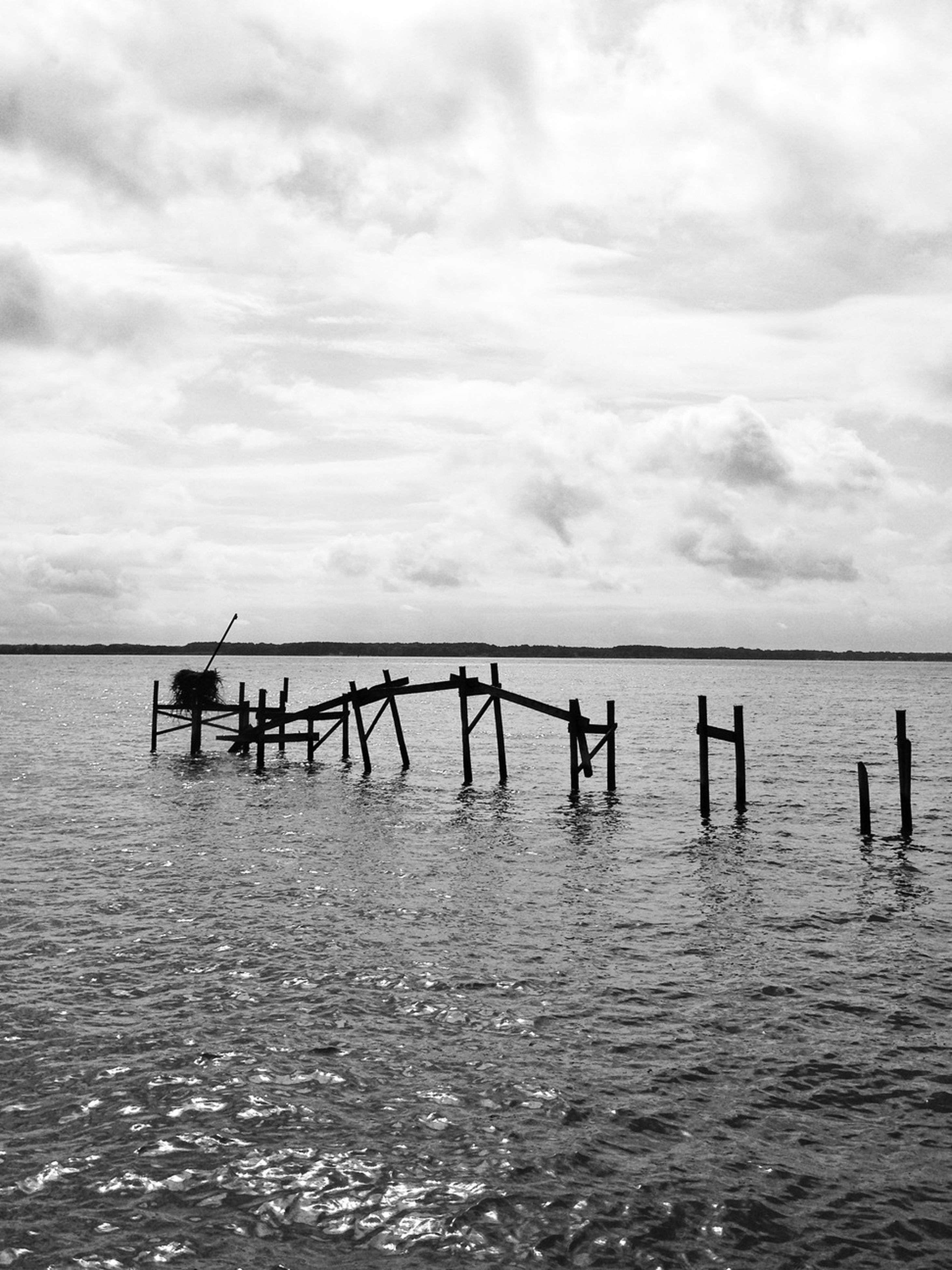 water, sea, sky, pier, tranquil scene, tranquility, waterfront, scenics, horizon over water, cloud - sky, beauty in nature, rippled, nature, wooden post, wood - material, cloudy, cloud, idyllic, jetty, day