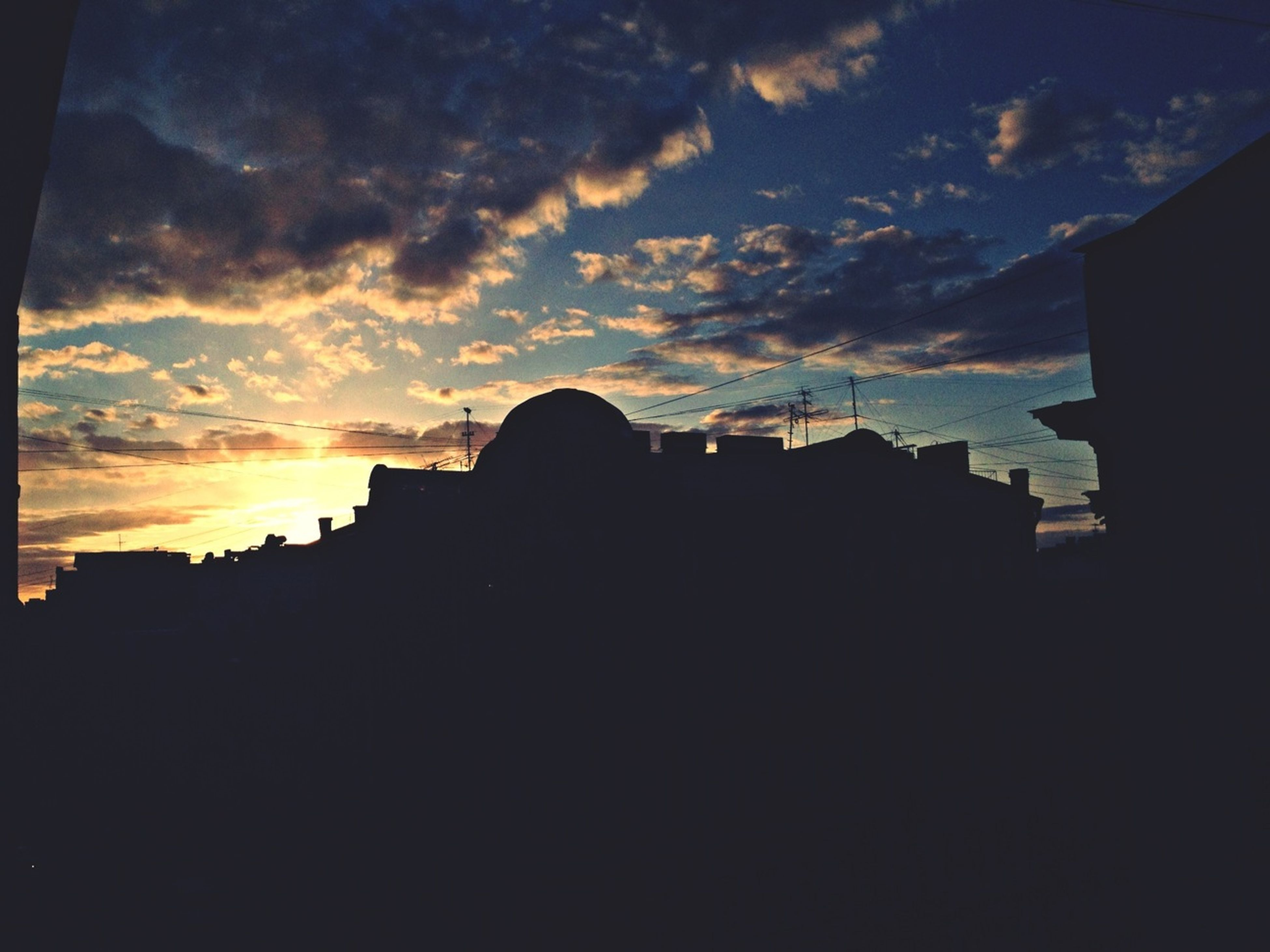 building exterior, architecture, sunset, silhouette, built structure, sky, cloud - sky, residential structure, cloud, house, residential building, building, city, dark, orange color, dusk, cloudy, outline, dramatic sky, outdoors