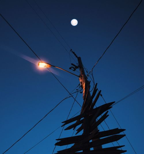 Had to upload on Eyem because Instagrams compression is too much. 😒 🌕🍺 Cable Low Angle View Power Line  Electricity  Real People Power Supply One Person Clear Sky Sky Blue Outdoors Moon Technology Standing Electricity Pylon Men Day Young Adult People Nightphotography EyeMeNewHere