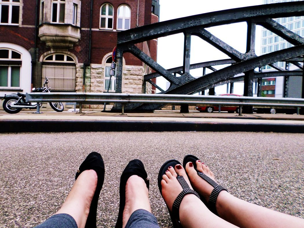 EyeEmNewHere Sandals Architecture Bridge Bridge - Man Made Structure Building Exterior Built Structure City Day Feet Human Leg Lifestyles Low Section Men Outdoors People Real People Transportation Two People Women Sitting Relax Ballerina Shoes EyeEm Gallery EyeEm Best Shots