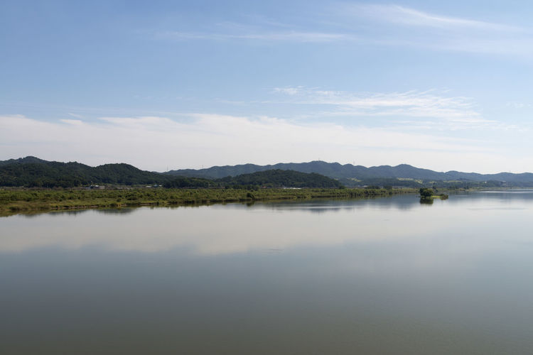 river view at Wungpodaegyo Bridge of Geumgang River in Iksan, Jeonbuk, South Korea Geumgang Geumgang River On The Bridge Beauty In Nature Cloud - Sky Day Lake Mountain Mountain Range Nature No People Outdoors Reflection River Scenics Sky Tranquil Scene Tranquility Water Waterfront