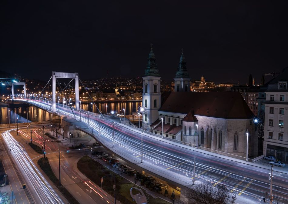 Relativity. Illuminated Night Architecture City Transportation Built Structure Long Exposure Shot Bridge - Man Made Structure Traffic Light Trail Speed Travel Destinations Long Exposure Sky Building Exterior Outdoors Motion City Life Budapestagram Budapest Streetphotography Budapest, Hungary Budapest Magyarország Hungary Road