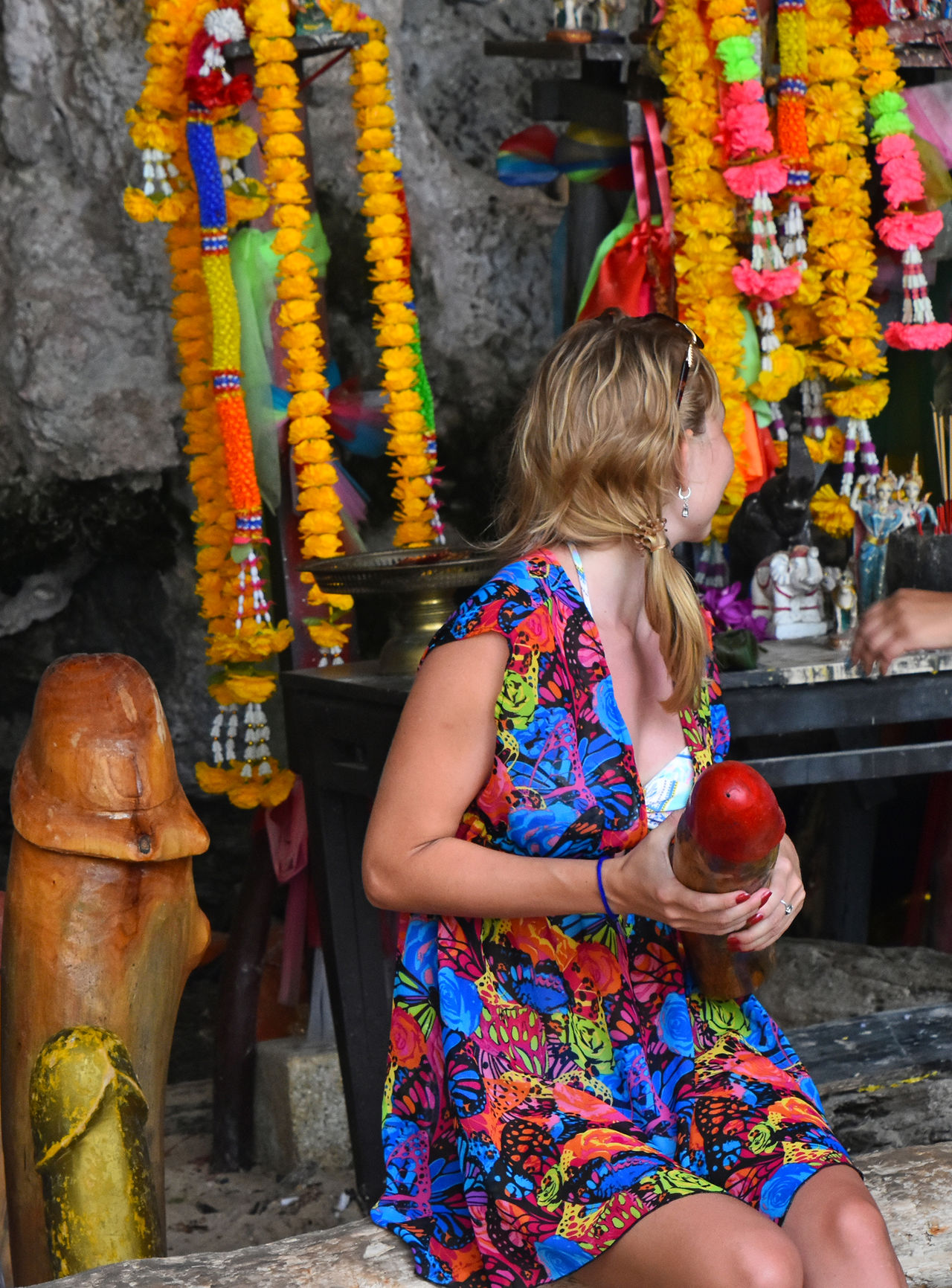 Irreverent tourists pose with wooden sacred religious attributes in front of cameras at Princess Cave shrine temple, Railay, Krabi, Thailnd, September 2015 Church Dishonor DISRESPECT Disrespectful  Irreverent Krabi Krabi Thailand Lack Of Culture Phranang Phranang Cave Pose Poser Posing Posing For The Camera Princess Cave Profanity Russian Srine Temple Thailand Tourists Telling Stories Differently
