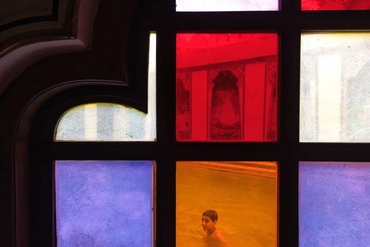window, indoors, real people, architecture, built structure, multi colored, day, close-up